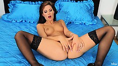 Sexy slut with red heels and black stockings rubs her small clit