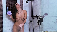 Young horny stud spies a sexy brunette MILF soaping her cunt fringe in the shower
