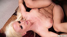 Blonde babe with implants bends over herself to take in a BBC