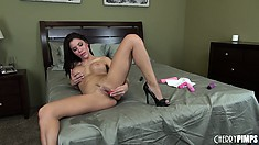 Aleksa Nicole sluts it up all by herself on the edge of the bed