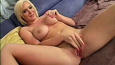 Alluring blonde India Summers sensually reveals the marvelous contours of her body
