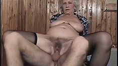 Gray-haired grandma loves to get deeply drilled by a young stud