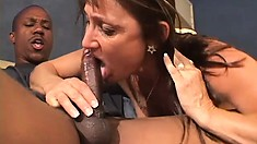Lustful cougar Jillian has a huge black rod stretching her tight holes
