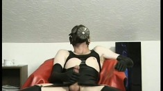 A weird dude with a latex fetish enjoys some solo masturbation