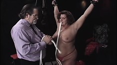 Bitch with massive tits gets punished by her experienced master