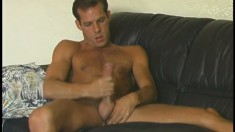 Splendid hairy stud strokes his massive long cock and shows big ass
