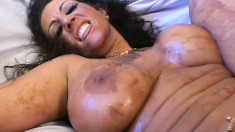 Hot-assed brunette oils her huge boobs and entices eager stud