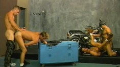 Hard-bodied gay men in leather straps fuck each other balls deep