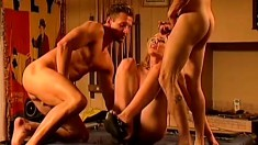 A horny girl gets at it with two well hung studs in a sex shop