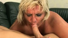 Chunky older woman Kokai gives a young stud a sloppy blowjob