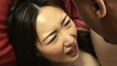 Asian whore gets her holes exploited by big black cocks on the couch