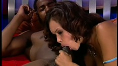 Petite ebony girl in blue stockings feeds her passion for black cock