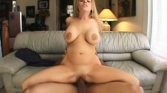 Busty blonde slides a dildo in her ass, paving the way for a throbbing black cock