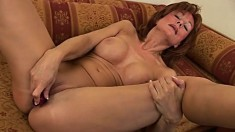 Sensuous redhead mom Nina fucks a dildo and finds outstanding pleasure