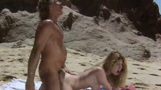 Sultry Tiffany Mynx seduces Randy West and fucks his cock at the beach