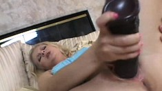 Aaralyn Barra gives in to temptation and drills her pussy with a massive toy