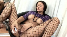 Bodacious brunette in fishnets Marissa Cruz fucks her pussy with a toy