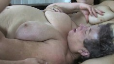 Huge granny lies back and a younger lesbian gives her pussy relief