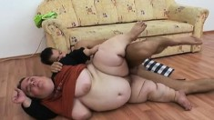 Fat midget slurps up his prick and gets her chubby cunny hammered