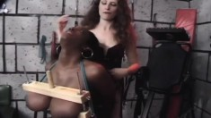 Huge boob black slave gets them tied up and tortured, then gets wrapped up