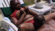Ebony chick with big hooters trades head and gets pumped by the pool