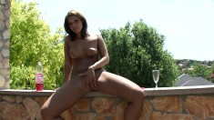 Provoking brunette with perky boobs pleases her snatch under the sun