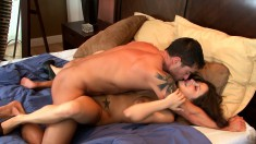 Alluring brunette with big hooters sucks and fucks a cock with passion