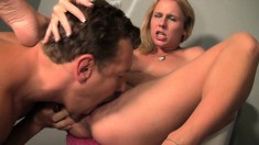 Kinky blonde slut Aria Austin disrobes for a gloryhole escapade