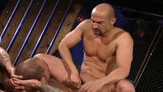 Bald headed hunk has a sexy tattooed stud fisting and fucking his ass