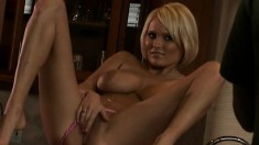 Buxom blonde exposes her curves and masturbates on the kitchen counter