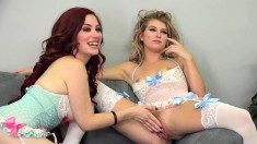 Blonde and redhead beauties set up a lesbian encounter on the couch