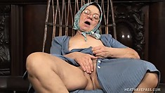 Old granny gets horny and fingers her wrinkly twat, and then knits