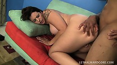 Tattooed tart Mandy gives her curvy white butt up to a black jackhammer
