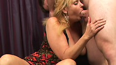 Big breasted blonde mom gets her needy holes drilled by a young stud