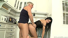Insatiable brunette bends over and takes an older guy's python