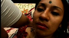 Slutty Indian chick sucks a cock while taking one up her tight hole