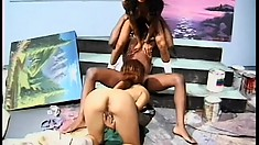 A pair of naughty chicks get down for some interracial action