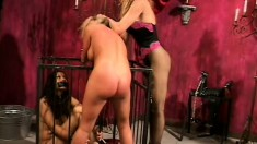 Bound blonde slave gets some rough treatment in bondage scene