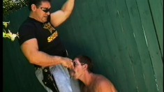 Two kinky policemen order a submissive guy to blow them both off
