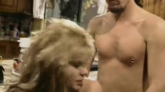 Sassy 80's blonde slut goes at it with her man in the kitchen