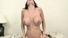 A big breasted MILF bounces her hot body on a rock hard cock