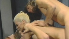 Big breasted milf Julie Rage gets her holes banged rough by two studs