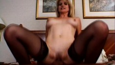 Busty milf in black stockings Kelly Ambrose wildly fucks a young stud