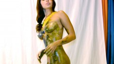Hot babe Cali is in a photo shoot putting paint all over her body