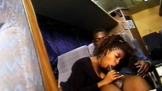 Buxom ebony chick Vanessa Blue gets pounded by a dark stud in the bus