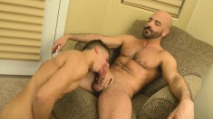 Adorable twink has an experienced guy plowing his tight ass on the bed