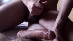 Sucking huge uncut cock and cum